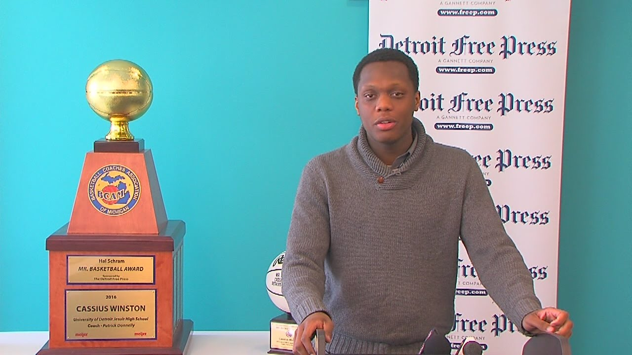Detroit U-D Jesuit state champion Cassius Winston with the Mr. Basketball trophy.