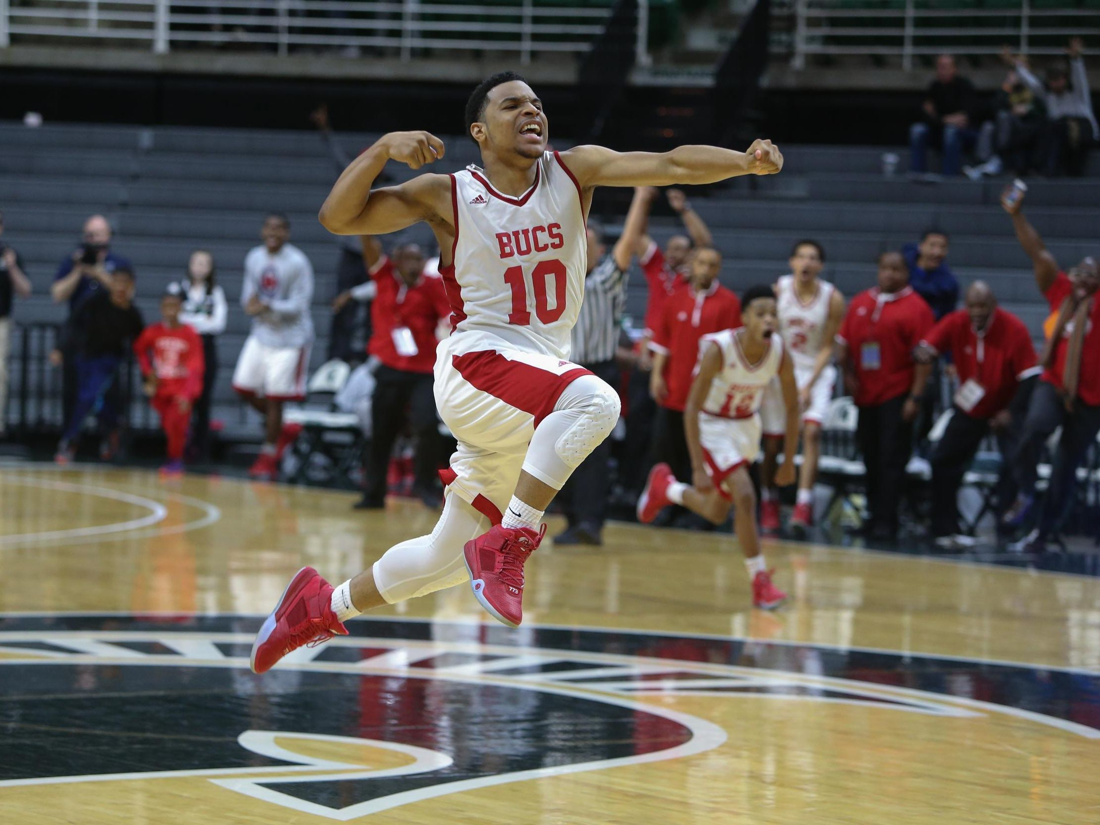 Beecher's Malik Ellison celebrates in this Free Press photo his state semifinal game-winner.